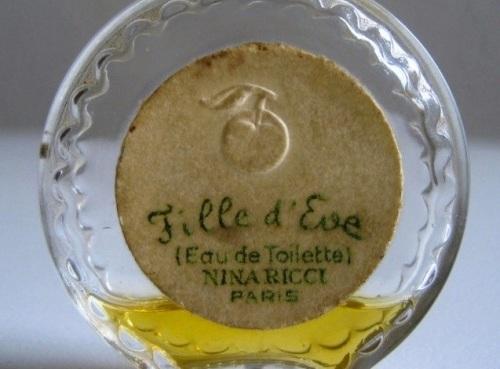 Fille-d-Eve-Et-flacon-montre-2-4cm-Miniature-NINA-RICCI