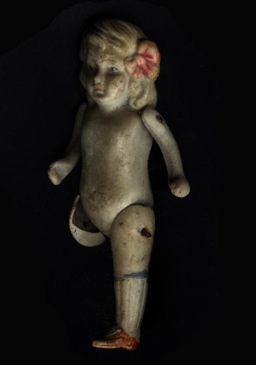 old_broken_doll