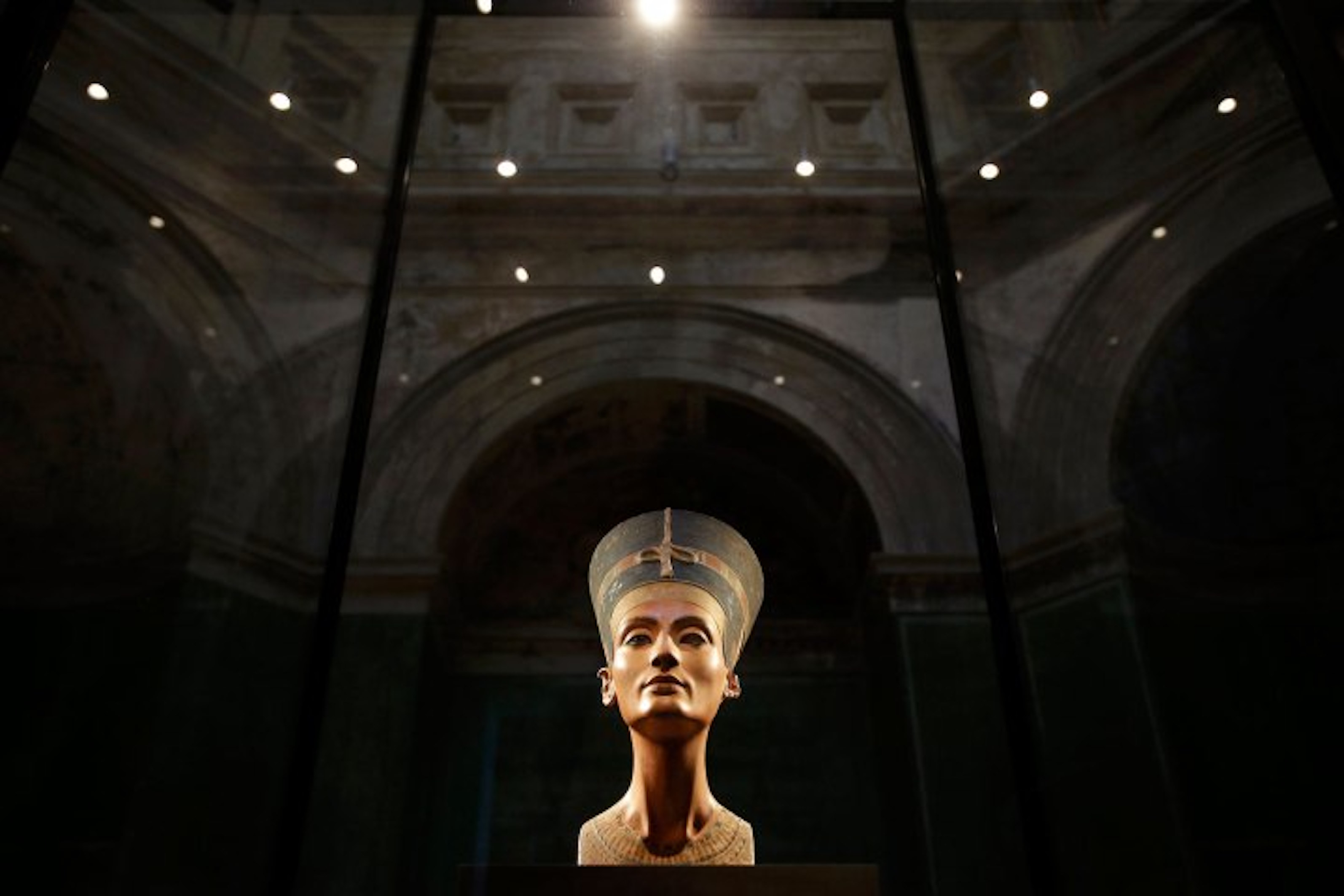 The Nefertiti bust is pictured during a press preview of the exhibition 'In The Light Of Amarna' at the Neues Museum in Berlin